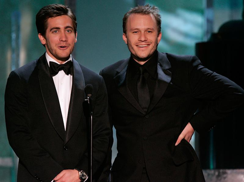 LOS ANGELES, CA - JANUARY 29: Actor Jake Gyllenhaal and Heath Ledger speak onstage during the 12th Annual Screen Actors Guild Awards held at the Shrine Auditorium on January 29, 2006 in Los Angeles, California. (Photo by Kevin Winter/Getty Images)