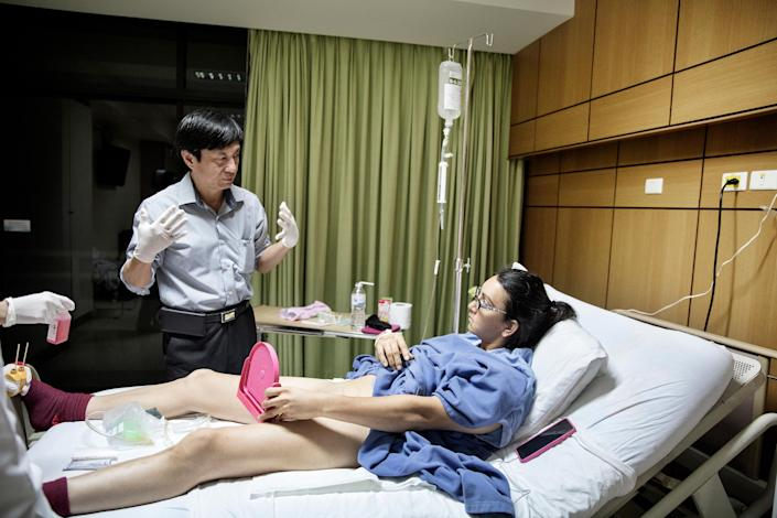 <p>More than a woman: Dr Suporn Watanyusakul shows patient Olivia Thomas her new vagina after gender reassignment surgery at a hospital in Chonburi, near Bangkok, Thailand, Feb. 3, 2017.<br>Thailand leads the world as a medical tourism destination, with gender-affirming surgery forming a strong niche. Treatment can be considerably cheaper than in other countries around the world, and the large numbers of patients mean that surgeons become highly experienced. The use of new technologies and procedures is also often given as a reason for Thailand's popularity among people seeking treatment for gender dysphoria. (Photo: Giulio Di Sturco) </p>