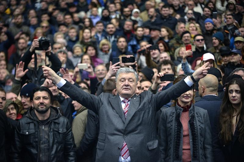"""Facing likely defeat, Poroshenko has asked Ukrainian voters to give him a second chance, warning against """"risk-taking"""" in choosing a leader (AFP Photo/Sergei CHUZAVKOV)"""