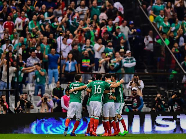 Mexican players celebrate a goal against Costa Rica during their 2018 FIFA World Cup qualifier football match in Mexico City on March 24, 2017 (Getty)