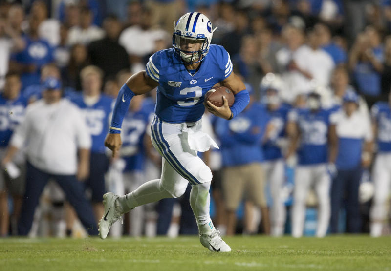 PROVO, UT - AUGUST 29: Jaren Hall #3 of the BYU Cougars rushes the ball against the Utah Utes during their game at LaVell Edwards Stadium on August 29, in Provo, Utah. (Photo by Chris Gardner/Getty Images)