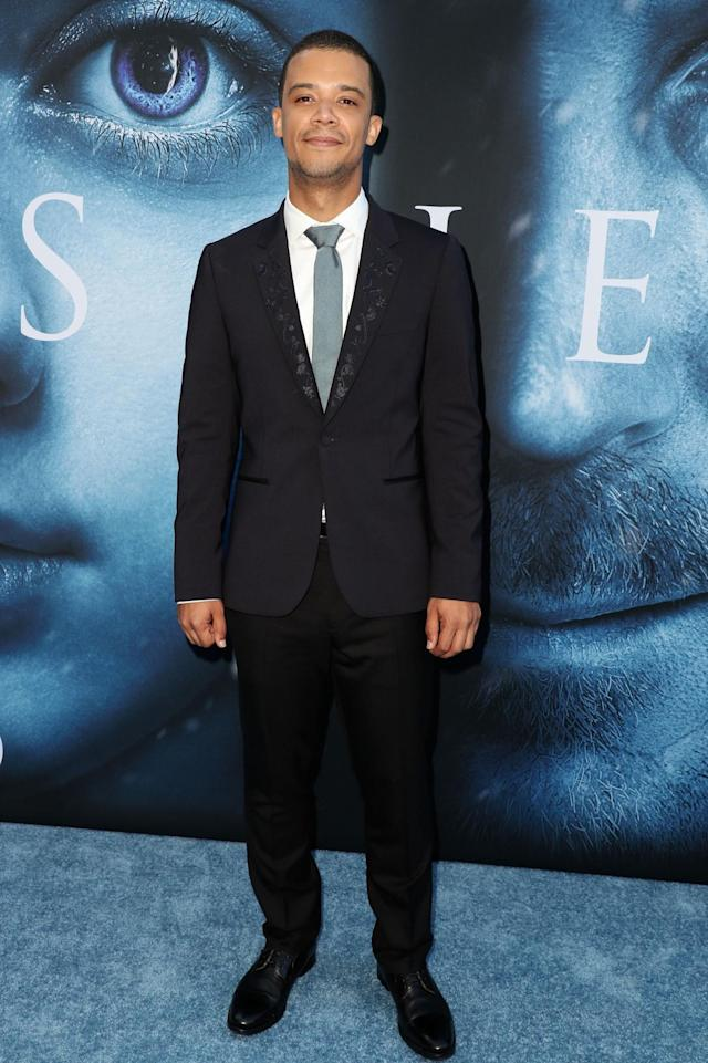 <p>Grey Worm arrived in a tailored black suit fitted with a stylish floral trim. (Photo: Rex) </p>