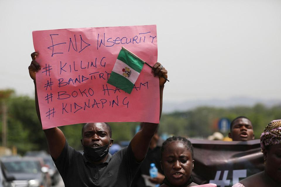 <p>Relatives of students abducted in Nigeria in March hold a demonstration </p> (AFP via Getty Images)