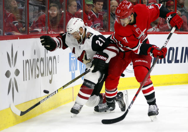 Carolina Hurricanes' Trevor van Riemsdyk (57) battles with Arizona Coyotes' Derek Stepan (21) during the second period of an NHL hockey game, Sunday, Dec. 16, 2018, in Raleigh, N.C. (AP Photo/Karl B DeBlaker)