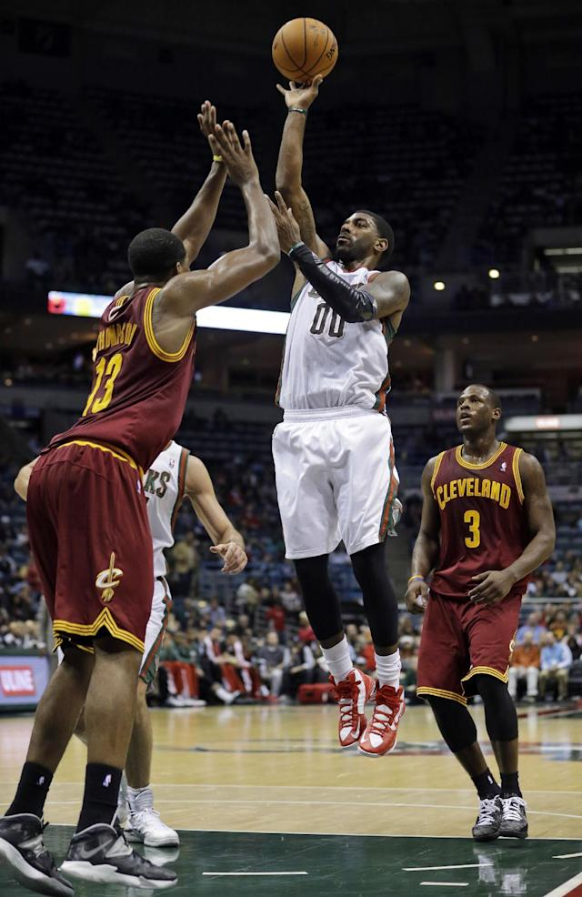 Milwaukee Bucks' O.J. Mayo shoots over Cleveland Cavaliers' Tristan Thompson during the second half of an NBA basketball game Wednesday, Nov. 6, 2013, in Milwaukee. The Bucks won 109-104. (AP Photo/Morry Gash)