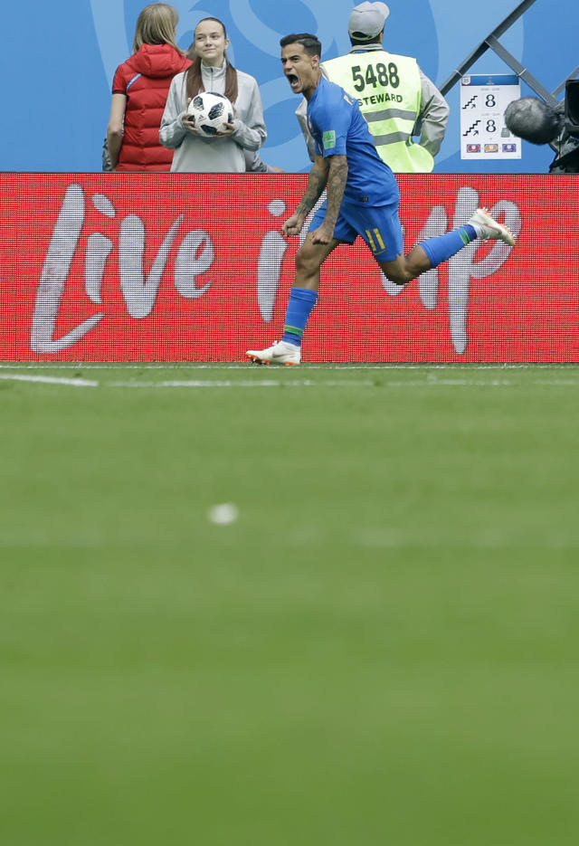 Brazil's Philippe Coutinho celebrates scoring the opening goal during the group E match between Brazil and Costa Rica at the 2018 soccer World Cup in the St. Petersburg Stadium in St. Petersburg, Russia, Friday, June 22, 2018. (AP Photo/Andre Penner)