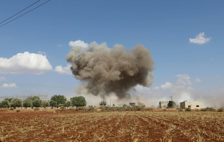 Smoke billows following Syrian government forces' bombardment around the village of Al-Muntar on the southern edges of rebel-held Idlib province