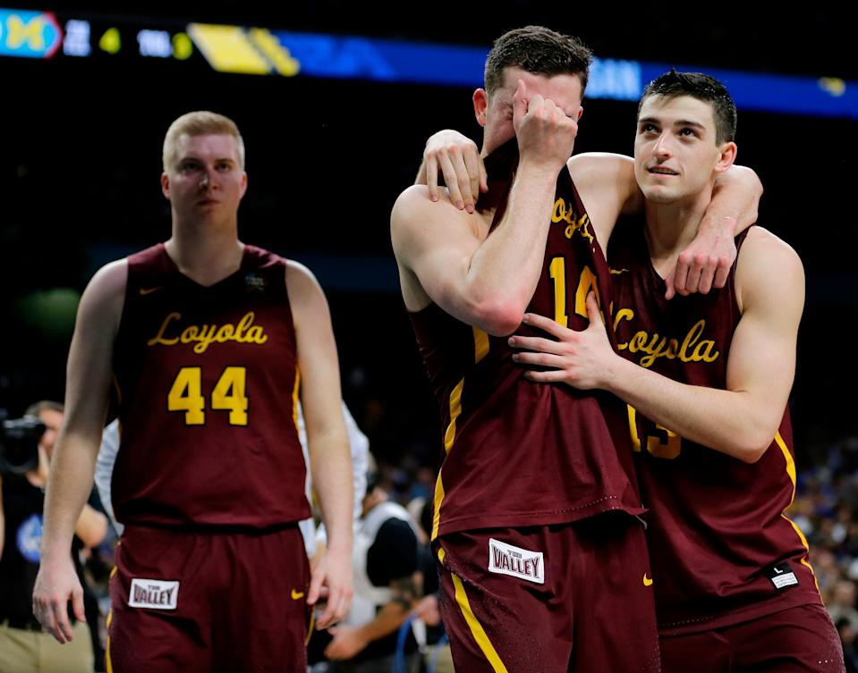 Loyola-Chicago's Ben Richardson embraces with Clayton Custer, right, after the Ramblers lost to Michigan in the Final Four. (AP)