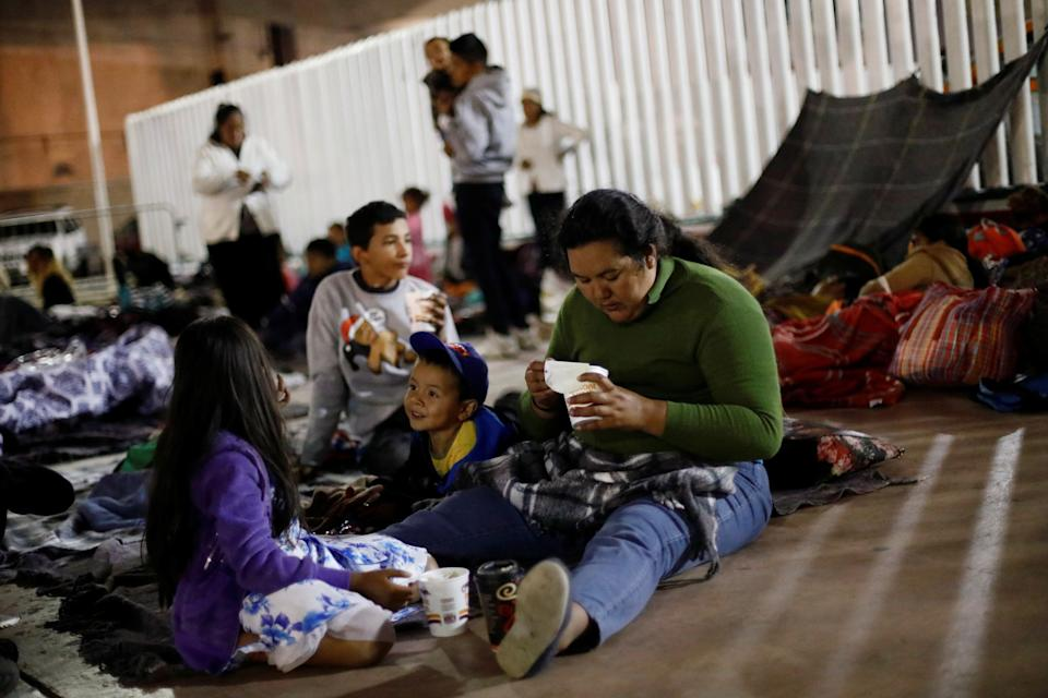 People get ready to spend the night near the San Ysidro checkpoint.