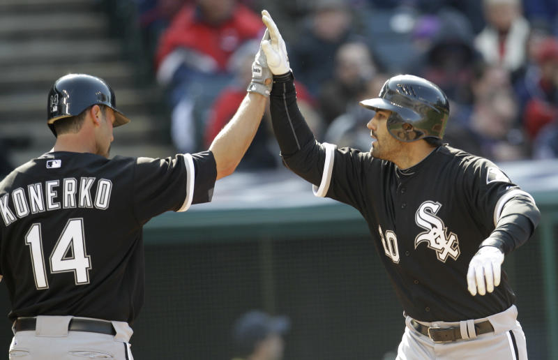 Chicago White Sox's Carlos Quentin, right, is congratulated by Paul Konerko after Quentin hit a two run home run in the third inning in an opening day baseball game against the Cleveland Indians, Friday, April 1, 2011, in Cleveland. Konerko scored. (AP Photo/Tony Dejak)