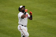 Baltimore Orioles' Maikel Franco reacts while running the the bases after hitting a two-run home run off New York Yankees relief pitcher Wandy Peralta (58) during the seventh inning of a baseball game, Sunday, May 16, 2021, in Baltimore. Orioles' Pedro Severino scored on the play. (AP Photo/Julio Cortez)