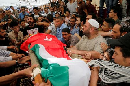FILE PHOTO: People attend the funeral of Mohammad Jawawdah in Amman, Jordan July 25, 2017. REUTERS/Muhammad Hamed/File Photo