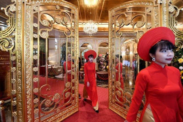 Staff wait to welcome guests in the lobby of the newly-inaugurated Dolce Hanoi Golden Lake hotel, the world's first gold-plated hotel