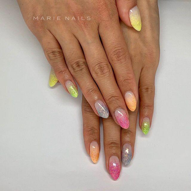 """<p>You don't always have to associate glitter with Christmas. Switch up your colours for your most summery manicure yet.</p><p><a href=""""https://www.instagram.com/p/BzBGpRhldHR/"""" rel=""""nofollow noopener"""" target=""""_blank"""" data-ylk=""""slk:See the original post on Instagram"""" class=""""link rapid-noclick-resp"""">See the original post on Instagram</a></p>"""