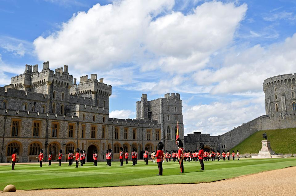 Guardsmen keep social distance as they stand in formation for a ceremony to mark Britain's Queen Elizabeth II official birthday, at Windsor Castle in Windsor, southeast England on June 13, 2020, as Britain's Queen Elizabeth II celebrates her 94th birthday this year. (Photo by TOBY MELVILLE / POOL / AFP) (Photo by TOBY MELVILLE/POOL/AFP via Getty Images)