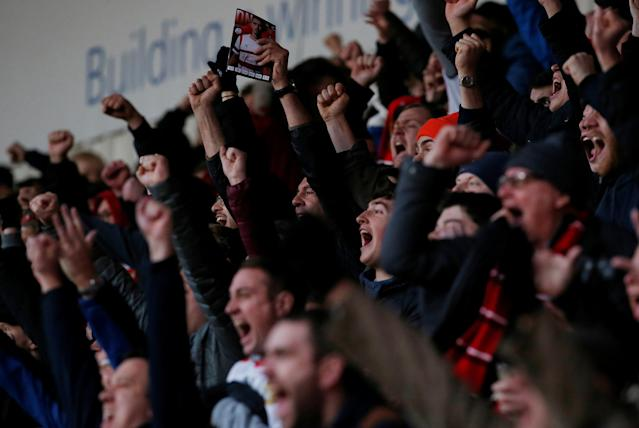 Soccer Football - FA Cup Second Round - Doncaster Rovers vs Scunthorpe United - Keepmoat Stadium, Doncaster, Britain - December 3, 2017 Doncaster Rovers fans celebrate Action Images/Craig Brough