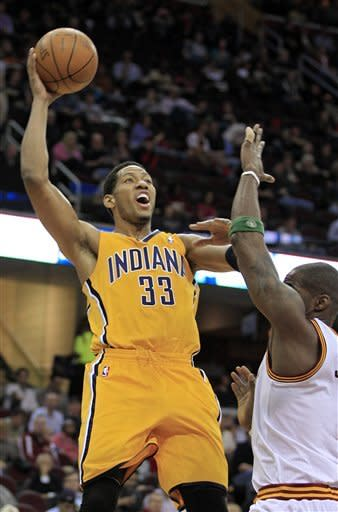 Indiana Pacers' Danny Granger (33) shoots over Cleveland Cavaliers' Antawn Jamison in the first quarter of an NBA basketball game Wednesday, April 11, 2012, in Cleveland. (AP Photo/Mark Duncan)
