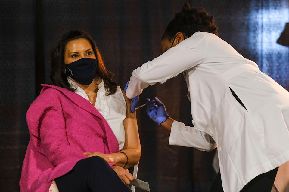 Michigan Gov. Gretchen Whitmer receives a dose of the Pfizer-BioNTech coronavirus vaccine Tuesday in Detroit at an event to promote and encourage Michigan residents to get the vaccine. A surge of new COVID-19 cases is sweeping through the U.S., with Michigan seeing the highest numbers of new infections. (Photo: Matthew Hatcher/Getty Images)