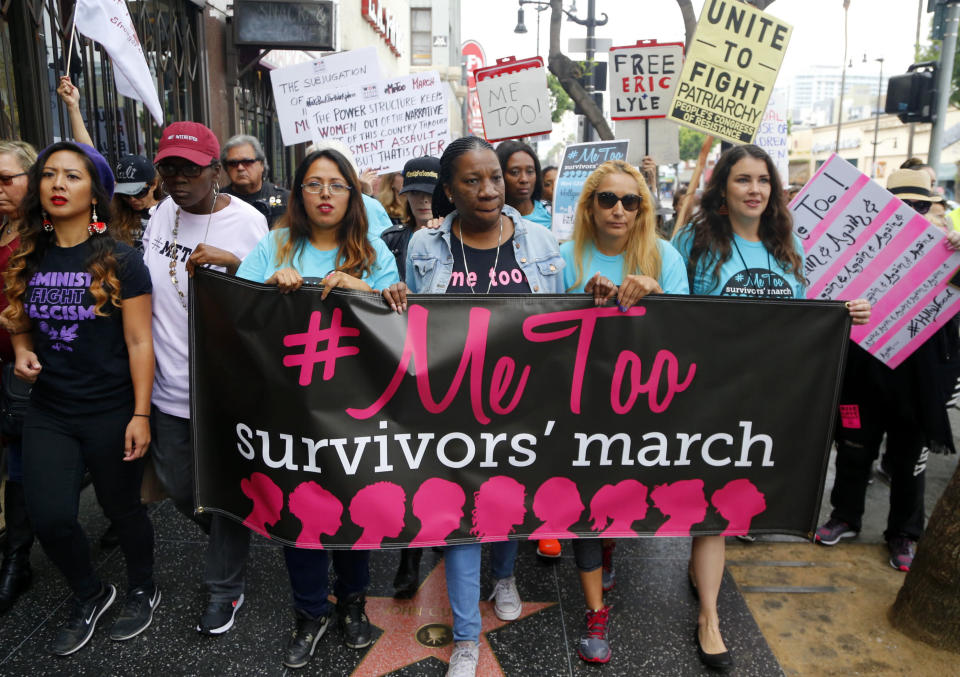 FILE - In this Nov. 1, 2017, file photo, Tarana Burke, founder and leader of the #MeToo movement, marches with others at the #MeToo March in the Hollywood section of Los Angeles. As the #MeToo movement marks the third year since it received global recognition, Burke is working to make sure it remains inclusive and reclaims its original intent: A focus on marginalized voices and experiences. (AP Photo/Damian Dovarganes, File)