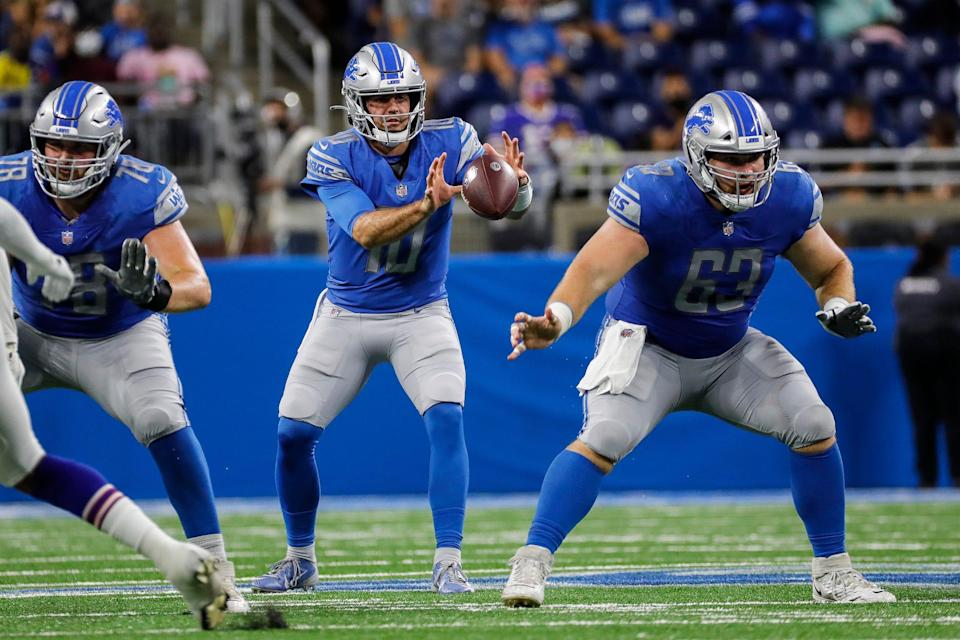 Detroit Lions quarterback David Blough (10) grabs a snap from center Evan Brown (63) against the Buffalo Bills during the second half of the preseason game at Ford Field in Detroit on Friday, Aug. 13, 2021.