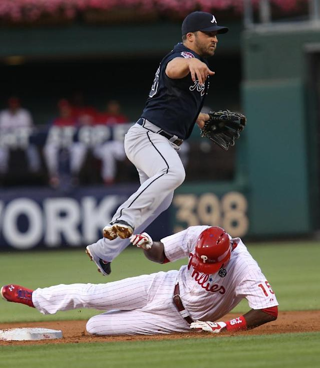 Philadelphia Phillies' John Mayberry Jr. is out at second as Atlanta Braves' Dan Uggla throws to first on a grounder by Cameron Rupp, who was out on a double play in the third inning of a baseball game, Friday, June 27, 2014, in Philadelphia. (AP Photo/Laurence Kesterson)