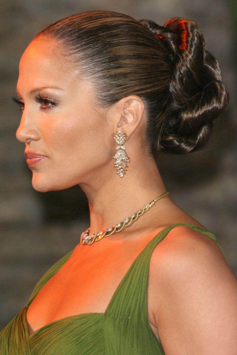 <p>Working her iconic slicked back bun with an intricate twist.</p>