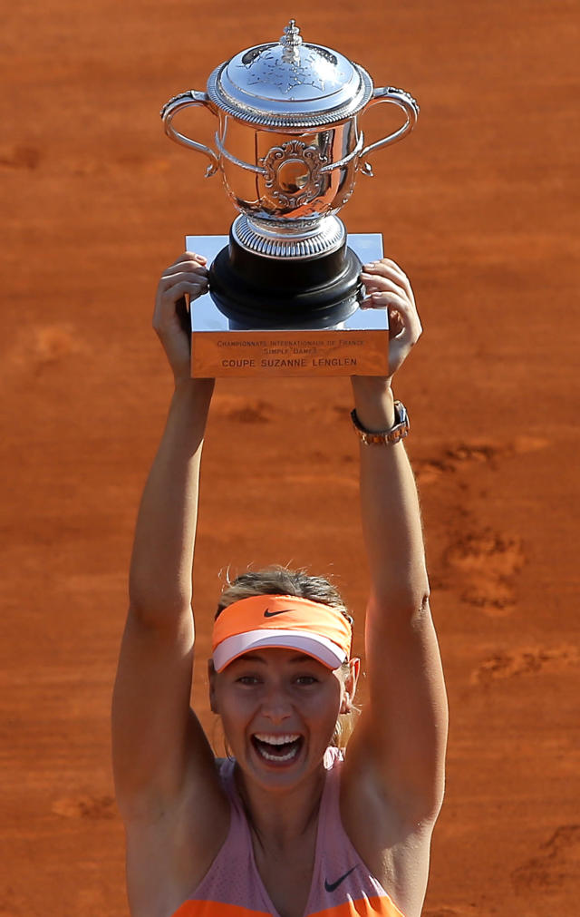 Russia's Maria Sharapova holds her trophy after winning the women's final match of the French Open tennis tournament against Romania's Simona Halep at the Roland Garros stadium, in Paris, France, Saturday, June 7, 2014. Sharapova won 6-4, 6-7, 6-4. (AP Photo/Michel Spingler)