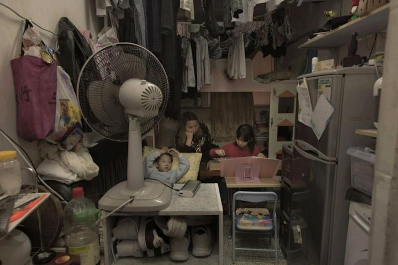 Li Suet-wen and her son, 6, and daughter, 8, live in a 11 square metre room. Photo: AP