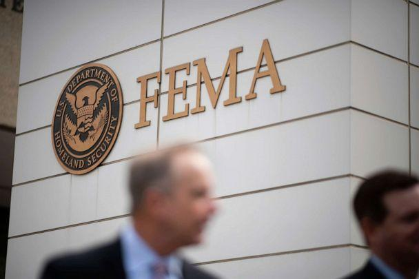 PHOTO: People walk in front of the Federal Emergency Management Agency logo at the FEMA headquarters in Washington, on Sept. 9, 2019. (Graeme Sloan/Sipa USA via AP, FILE)