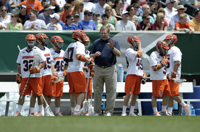FILE - Syracuse head coach John Desko is shown during an NCAA college Division I championship final lacrosse game against Duke in Philadelphia, in this Monday, May 27, 2013, file photo. Syracuse men's lacrosse coach John Desko, who built a Hall of Fame career as both a player and coach, announced his retirement on Monday, June 7, 2021, in the wake of a disappointing season. (AP Photo/Michael Perez, File)