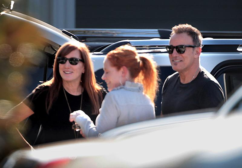 Bruce Springsteen ,right, and his wife Patti Scialfa , far left, leave the Royal Poinciana Chapel in Palm Beach, Fla. Tuesday, June 21, 2011, after a memorial service for Clarence Clemons, a long time friend and saxophone player for Bruce Springsteen's E Street Band. Clemons died June 18, 2011. (AP Photo/The Palm Beach Post, Brandon Kruse)   MAGS OUT; TV OUT; NO SALES