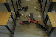 Shoes of the kidnapped students from Government Science Secondary School are seen inside their class room Kankara, Nigeria, Wednesday, Dec. 16, 2020. Rebels from the Boko Haram extremist group claimed responsibility Tuesday for abducting hundreds of boys from a school in Nigeria's northern Katsina State last week in one of the largest such attacks in years, raising fears of a growing wave of violence in the region. (AP Photo/Sunday Alamba)