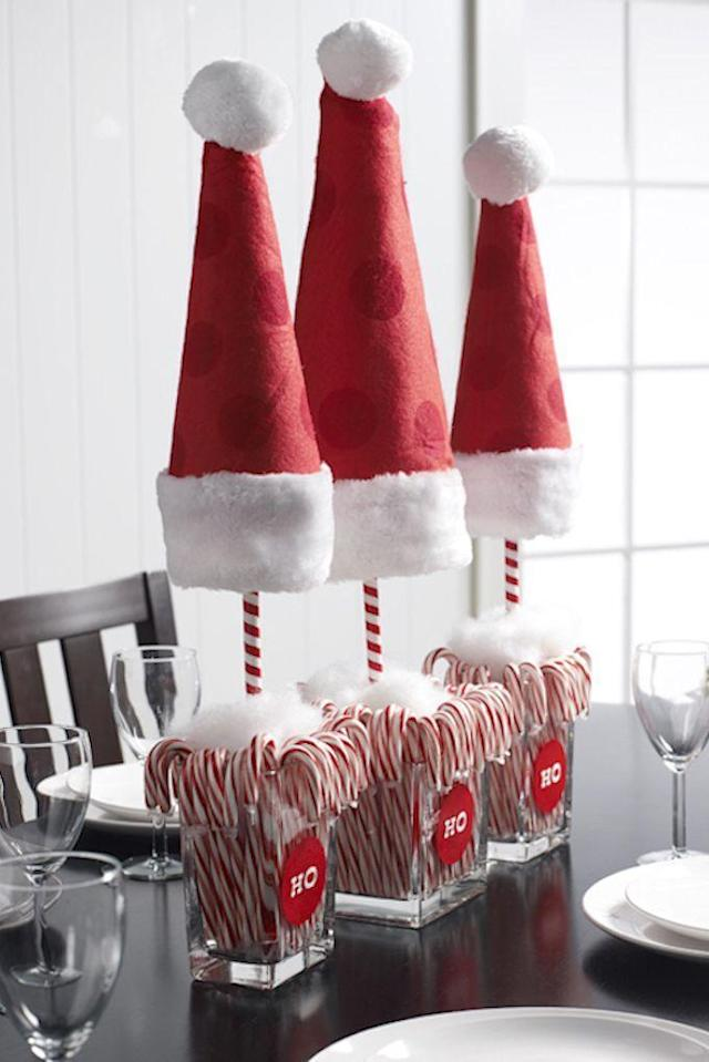 """<p>Keep things lighthearted with this partly-edible Santa """"topiary"""" centerpiece. Little ones will especially love it!</p><p><strong>Get the tutorial at <a href=""""http://diycandy.com/2014/12/diy-christmas-topiary-with-santa-hats/"""" rel=""""nofollow noopener"""" target=""""_blank"""" data-ylk=""""slk:DIY Candy"""" class=""""link rapid-noclick-resp"""">DIY Candy</a>.</strong></p><p><strong><a class=""""link rapid-noclick-resp"""" href=""""https://www.amazon.com/b?ie=UTF8&node=17369016011&tag=syn-yahoo-20&ascsubtag=%5Bartid%7C10050.g.644%5Bsrc%7Cyahoo-us"""" rel=""""nofollow noopener"""" target=""""_blank"""" data-ylk=""""slk:SHOP CANDY CANES"""">SHOP CANDY CANES</a><br></strong></p>"""