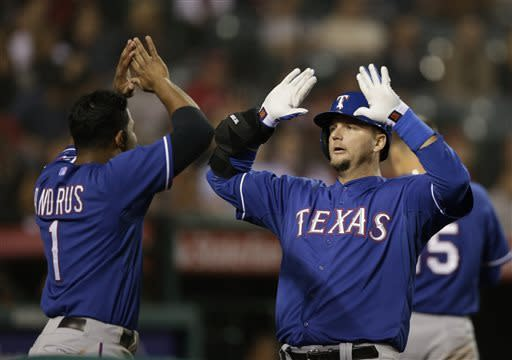 Texas Rangers' A.J. Pierzynski, right, celebrates his home run with Elvis Andrus during the ninth inning of a baseball game against the Los Angeles Angels in Anaheim, Calif., Monday, April 22, 2013. (AP Photo/Jae C. Hong)