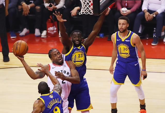 Kawhi Leonard #2 of the Toronto Raptors attempts a shot against Draymond Green #23 of the Golden State Warriors in the first quarter during Game One of the 2019 NBA Finals at Scotiabank Arena on May 30, 2019 in Toronto, Canada. (Photo by Gregory Shamus/Getty Images)