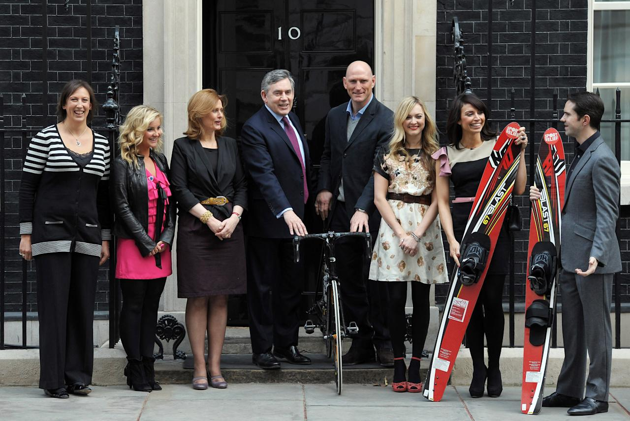 LONDON, ENGLAND - MARCH 16:  (L-R) Miranda Hart, Helen Skelton, Sarah Brown, Prime Minister Gordon Brown, Lawrence Dallaglio, Fearne Cotton, Christine Bleakley and Jimmy Carr pose for a photocall for Sport Relief at 10 Downing Street on March 16, 2010 in London, England.  (Photo by Ian Gavan/Getty Images)
