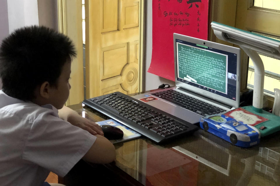 Fourth grader Han Binh Cuong attends a lesson via virtual classroom in Hanoi, Vietnam Monday, Sept. 6, 2021. Over 20 million Vietnamese students start a new school year on Monday, many of them on virtual classrooms as more than half of the country is in lockdown to contain a COVID-19 surge. (AP Photo/Binh Huy)
