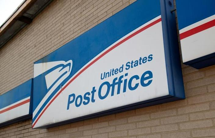 US Postmaster General Megan Brennan says the Postal Service expects to lose $13 billion in revenue this fiscal year alone as a direct result of the COVID-19 crisis (AFP Photo/SAUL LOEB)