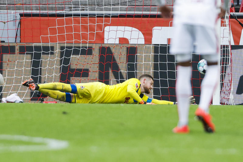 COLOGNE, GERMANY - OCTOBER 18: Goalkeeper Timo Horn (1.FC Koeln) gets the 0:1 goal per penalty during the Bundesliga match between 1. FC Koeln and Eintracht Frankfurt at RheinEnergieStadion on October 18, 2020 in Cologne, Germany. (Photo by Mika Volkmann/Getty Images)