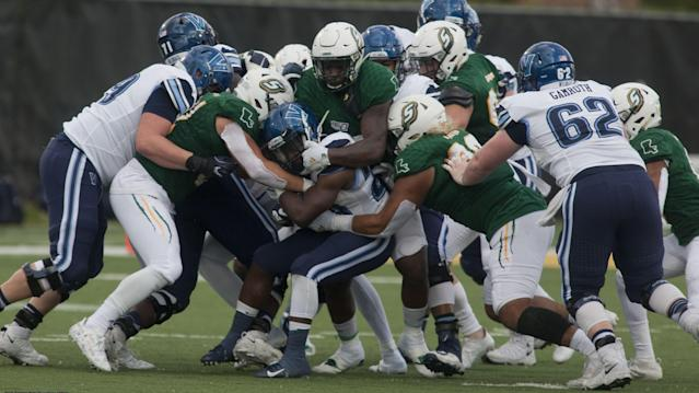 Southeastern defenders swarm Villanova running back DeeWil Barlee in the first half Saturday in the first round of playoffs at Strawberry Stadium in Hammond. (Photo by Randy Bergeron/SLU Sports Info)