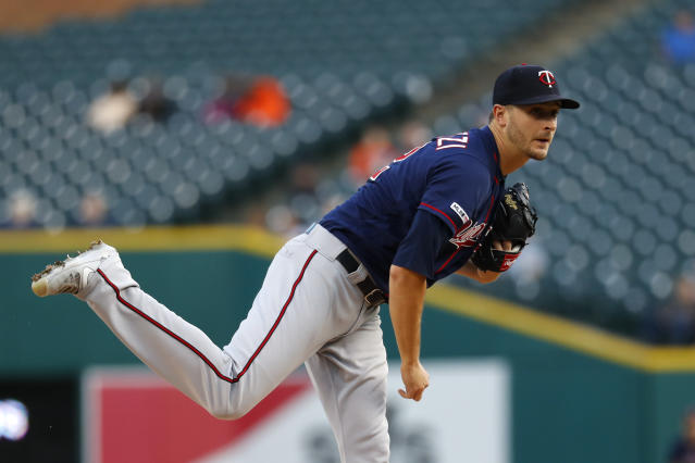 Minnesota Twins pitcher Jake Odorizzi watches a throw to a Detroit Tigers batter during the first inning of a baseball game in Detroit, Tuesday, Sept. 24, 2019. (AP Photo/Paul Sancya)