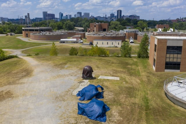 Confederate statues are covered in tarps while being stored at a waste water treatment plant in Richmond, Virginia (Steve Helber/AP)