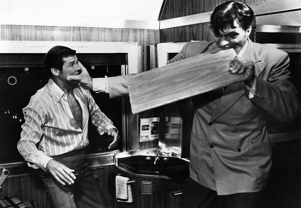 <p>Roger Moore fights with Richard Kiel, as Jaws, who bites through a board in a scene from the film 'The Spy Who Loved Me', 1977. </p>