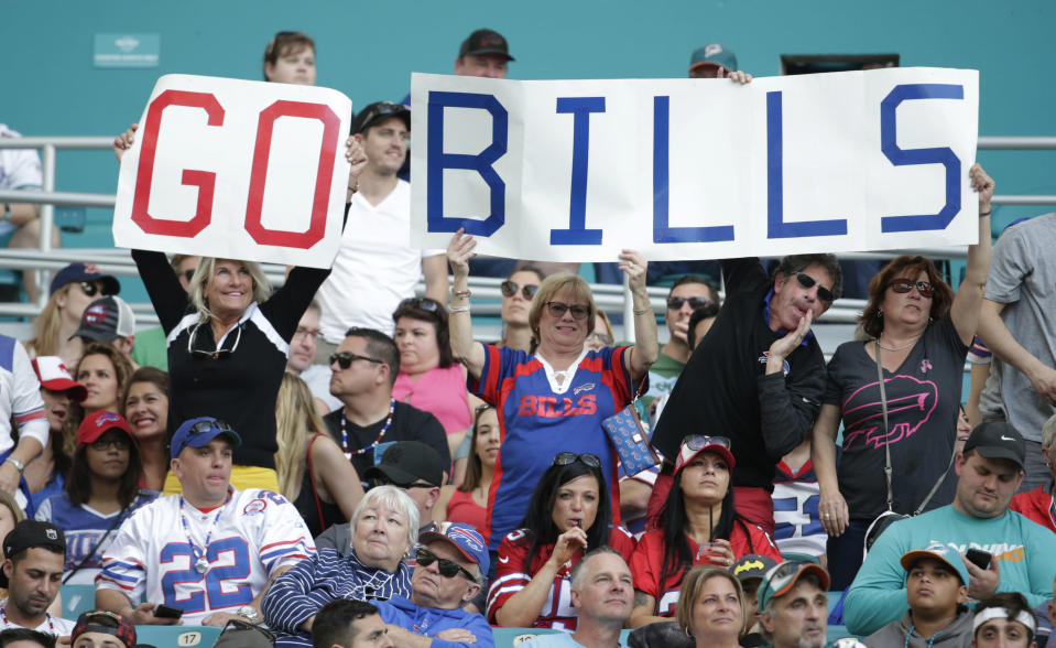 Buffalo Bills fans cheer the team, during the first half of an NFL football game against the Miami Dolphins, Sunday, Dec. 31, 2017, in Miami Gardens, Fla. (AP Photo/Lynne Sladky)