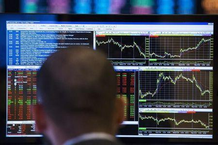 A trader looks at his screen as he works on the floor of the New York Stock Exchange