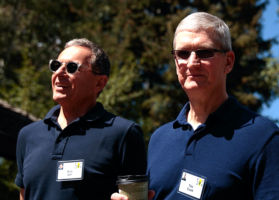 (L to R) Bob Iger, chief executive officer of The Walt Disney Company, walks with Tim Cook, chief executive officer of Apple Inc., as they attend the annual Allen & Company Sun Valley Conference, July 6, 2016 in Sun Valley, Idaho. (Photo by Drew Angerer/Getty Images)