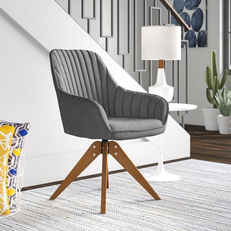 "Brister Swivel Side Chair<br><br><strong>Discount:</strong> 20% off<br><br><strong>The Hype: </strong>4.6 out of 5 stars and 352 reviews<br><br><strong>Deal Hunters Say: </strong>""This chair is so cute! It is comfy and hugs my sides when I sit all the way back. I did anticipate that the seat itself would've been a little bit wider but it is very comfy to work at all day. Hopefully, it holds up well since I will be using it daily, but it's been great so far. Very mid-century modern feel to it.""<br><br><em>Shop </em><strong><em><a href=""https://fave.co/3luoy2T"" rel=""nofollow noopener"" target=""_blank"" data-ylk=""slk:Corrigan Studio"" class=""link rapid-noclick-resp"">Corrigan Studio</a></em></strong><br><br><strong>Corrigan Studio</strong> Brister Swivel Side Chair, $, available at <a href=""https://go.skimresources.com/?id=30283X879131&url=https%3A%2F%2Ffave.co%2F3cZfUpF"" rel=""nofollow noopener"" target=""_blank"" data-ylk=""slk:Wayfair"" class=""link rapid-noclick-resp"">Wayfair</a>"