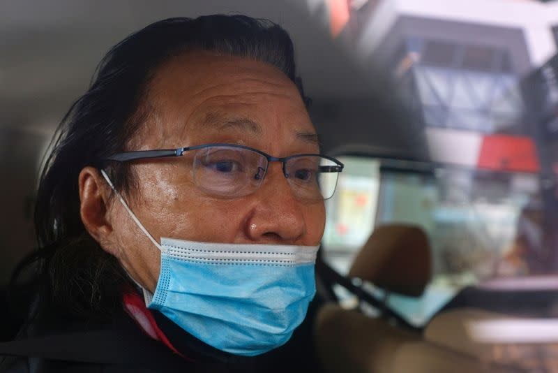 Daniel Wong Kwok-tung is seen inside a police vehicle in Hong Kong