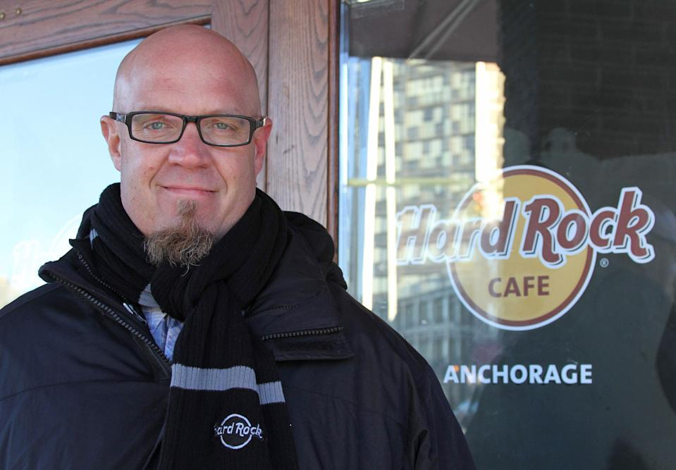 In this photo taken Nov. 20, 2013, general manager Scott Brokaw poses outside the new Hard Rock Cafe under construction in Anchorage, Alaska. The restaurant will open in late spring 2014, and is another national chain that is opening locations in Alaska's largest city. (AP Photo/Mark Thiessen)