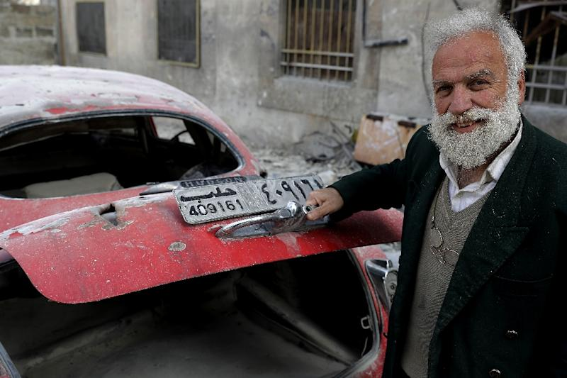 Mohammed Mohiedin Anis always had a passion for cars, but at his home in Aleppo's formerly rebel-held al-Shaar neighbourhood, his collection is in a sorry state (AFP Photo/JOSEPH EID)